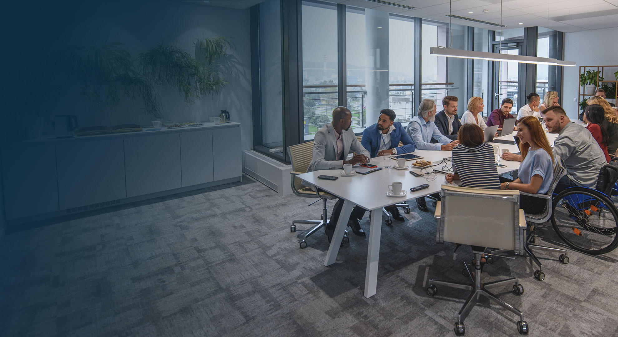 A group of people having a meeting in a large meeting room